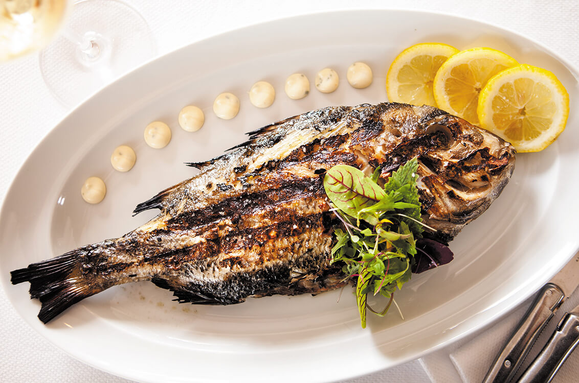 Wood-grilled whole fish