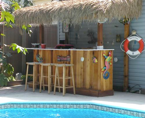a tiki bar by the pool